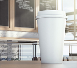 Paper coffee cup in a coffee shop in Richmond, BC
