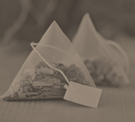 Tea sachets of organic Two Leaves and a Bud tea, sold though Canterbury Coffee