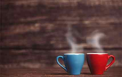 Two cups of coffee caffeine vs decaf